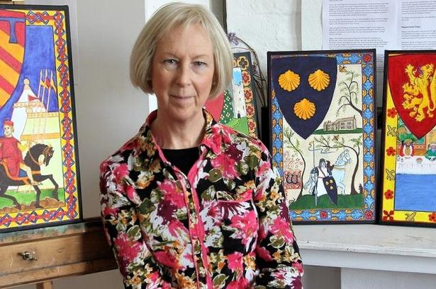 Diana Braybrook with some of the Magna Carta paintings